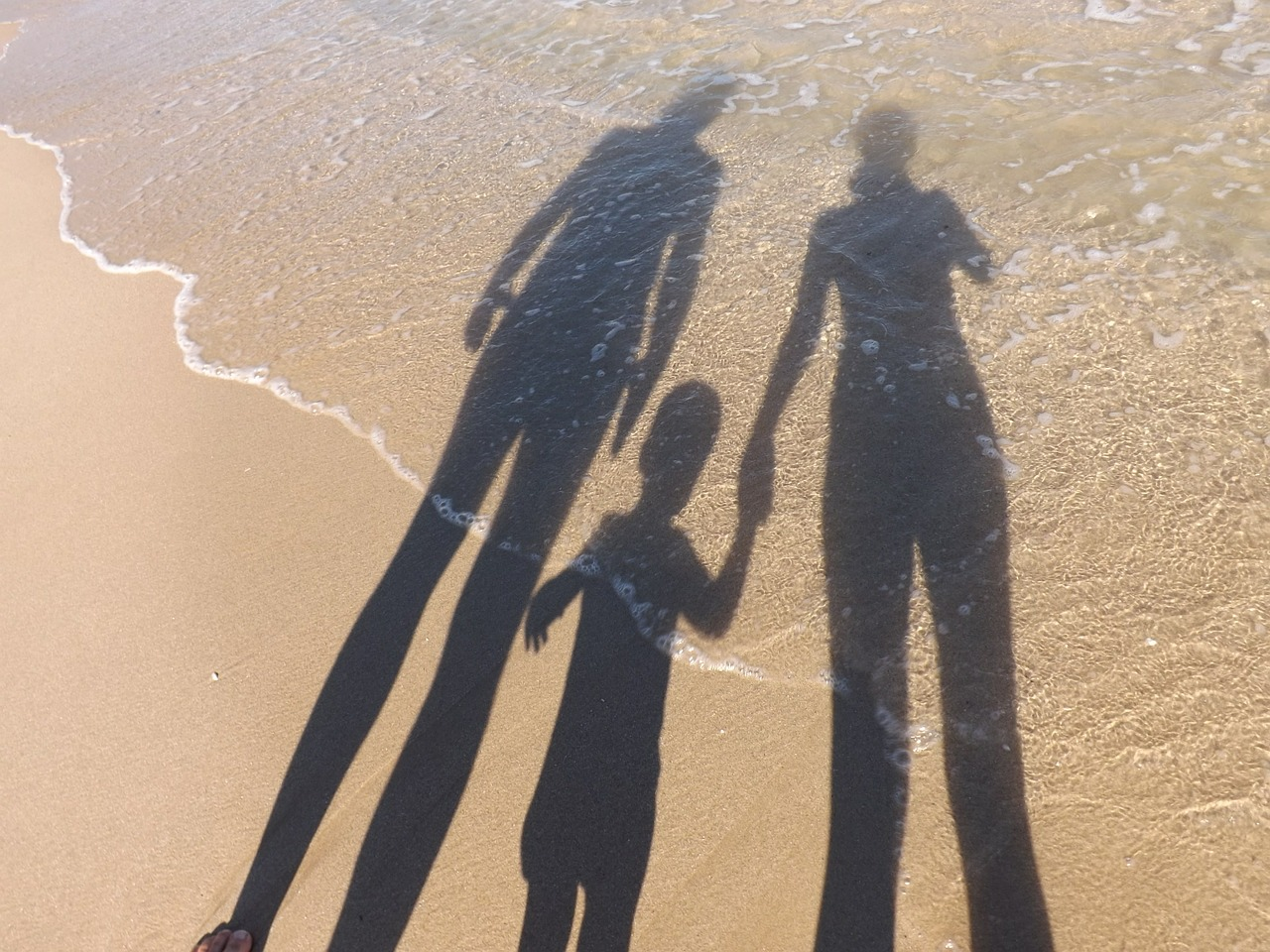 family silhouette on a beach