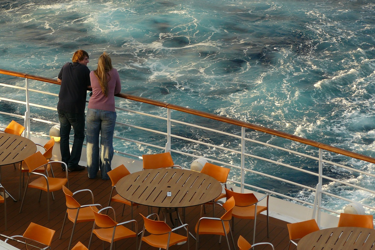 pair overlooking sea on a cruise ship