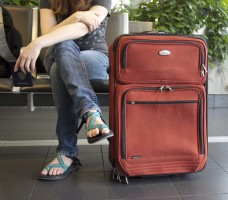 Woman delayed at airport with suitcase