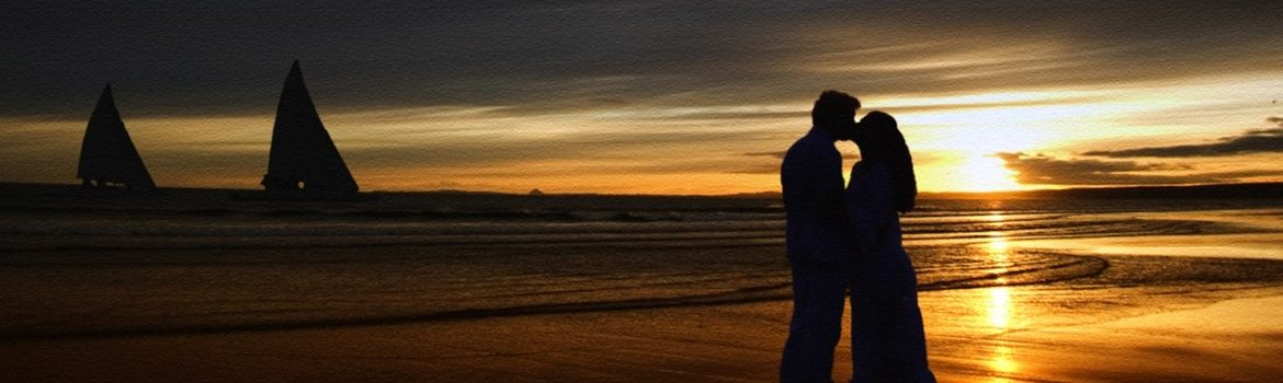 Kissing on the beach at sunset