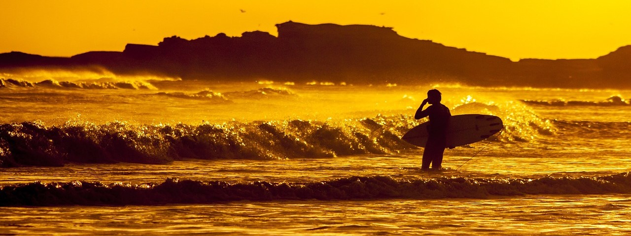 Surfing in Europe at Sunset