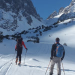 Image of couple skiing in mountains