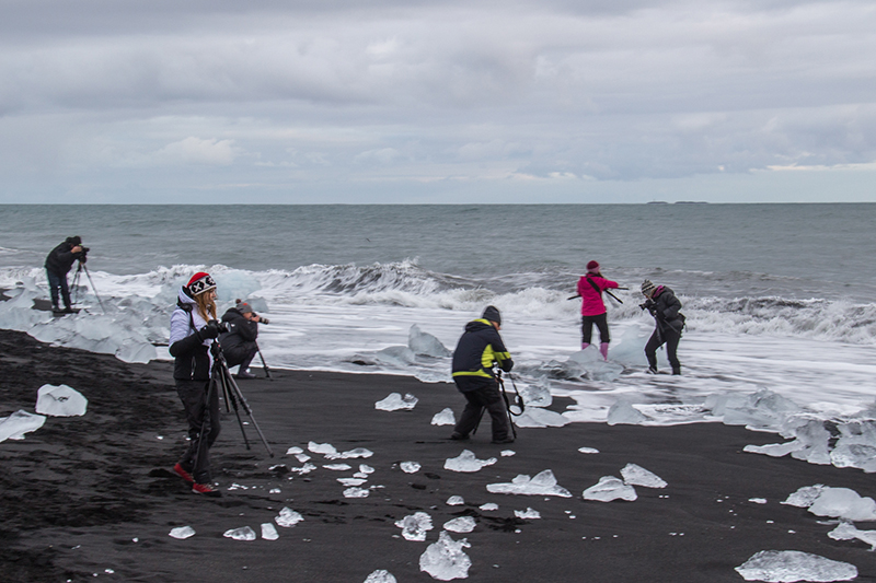 Image of group doing photography on beach in Iceland
