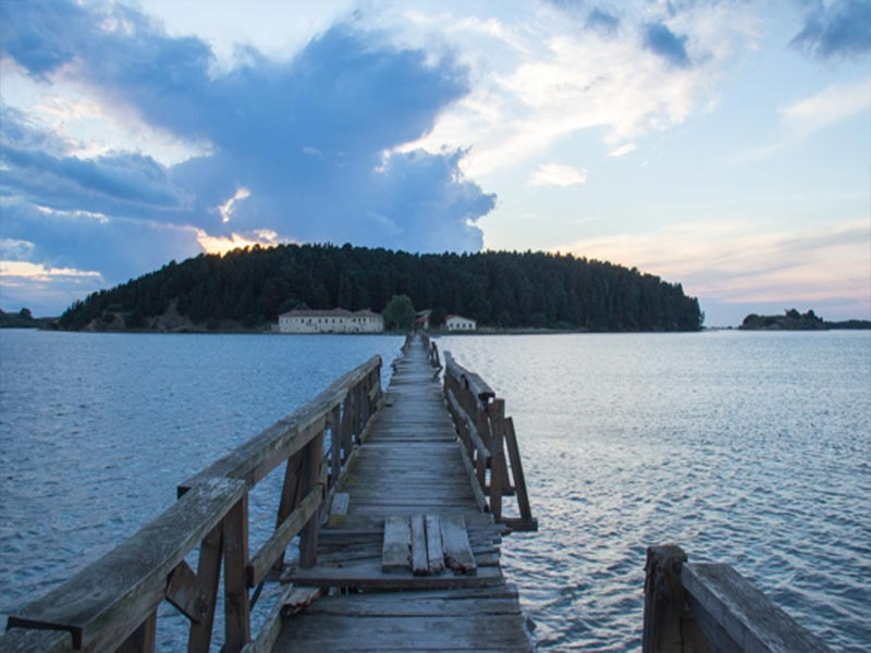 Image of wooden bridge across Narta Lagoon to Zvernec Island