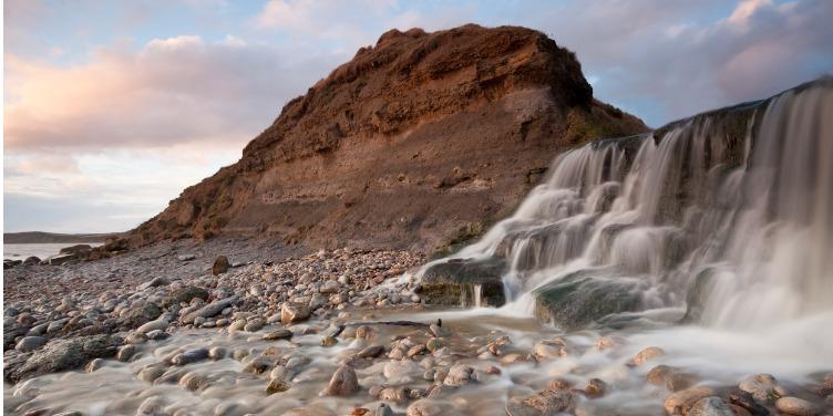 an image of the waterfall at the beach on the Jurassic Coast walk near Osmington Mills, Dorset