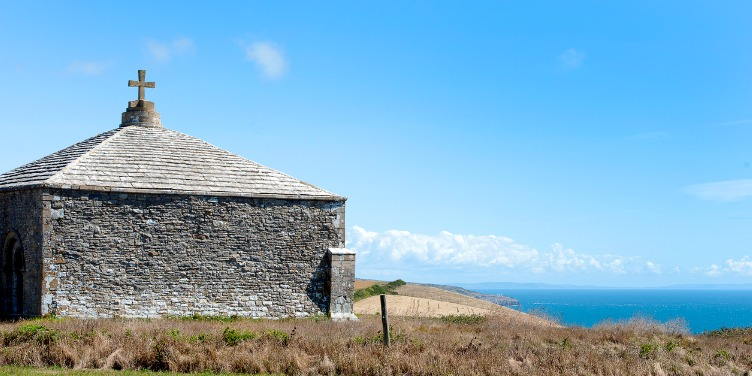 an image of St Aldhelm's Chapel, on the Jurassic Coast in Dorset