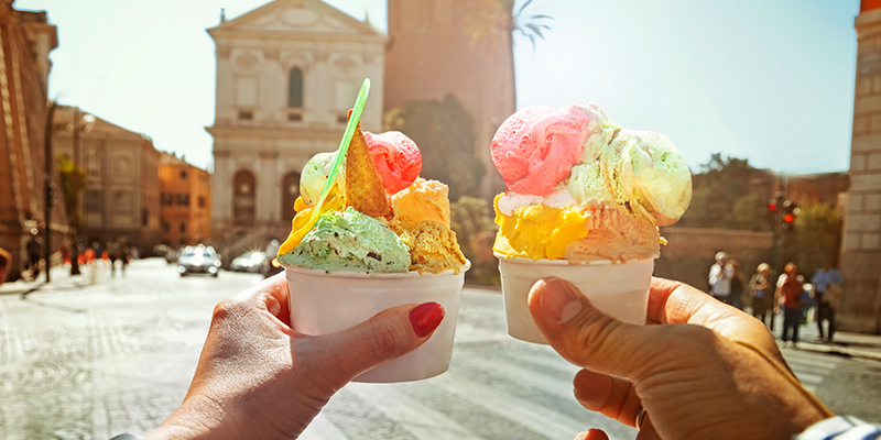 Couple-with-beautiful-bright-sweet-Italian-ice-cream-with-different-flavors-in-the-hands