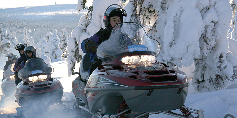 Snowmobiling in the snow in Finland – a fun activity to do in the winter