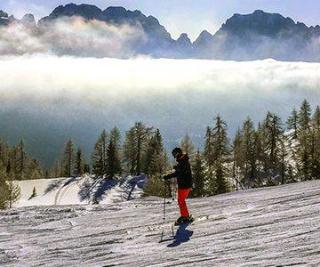 Skiier in Dolomites