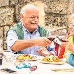 senior couple enjoying food on holiday