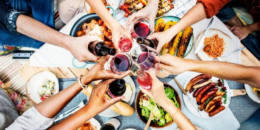 people toasting together over dinner