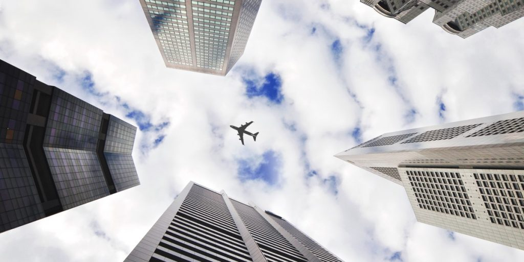 Airplane flying above buildings