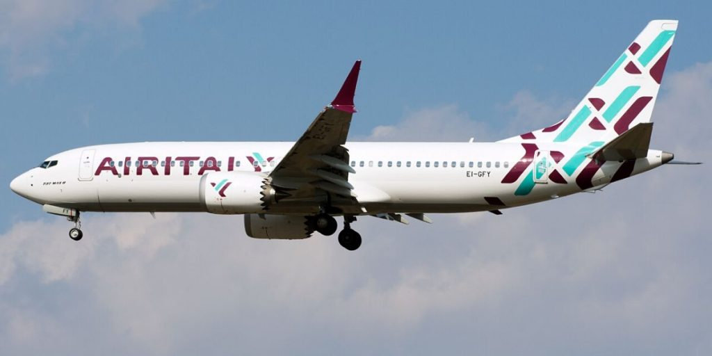 air italy plane above clouds