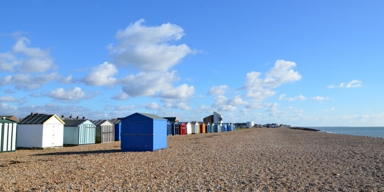 Rows of colourful beach huts sat on Hayling Island beach