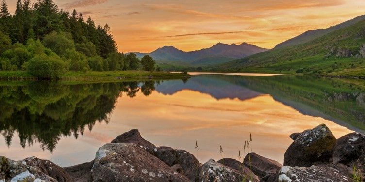 Sunset over a lake in Snowdonia National Park in Wales