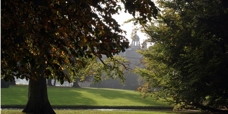 an image of Belton House, Lincolnshire, through the trees