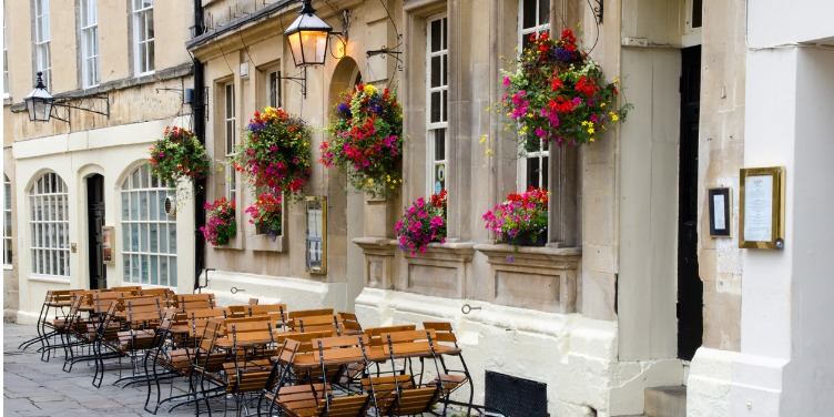 an image of al fresco dining at a street cafe in Bath