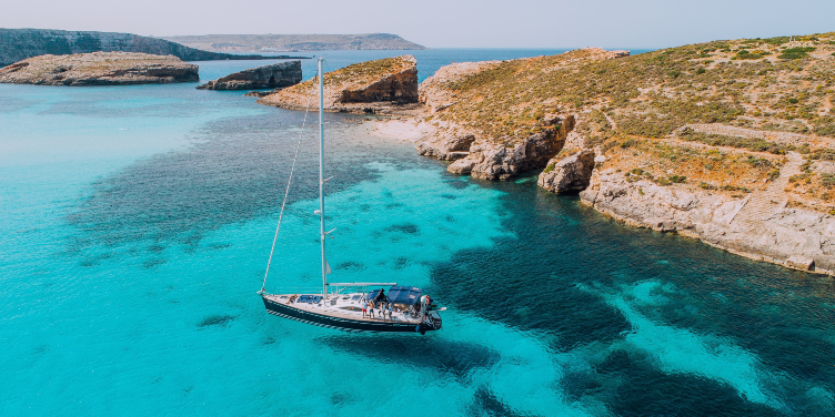 an image of a boat in the Blue Lagoon of Comino, Malta