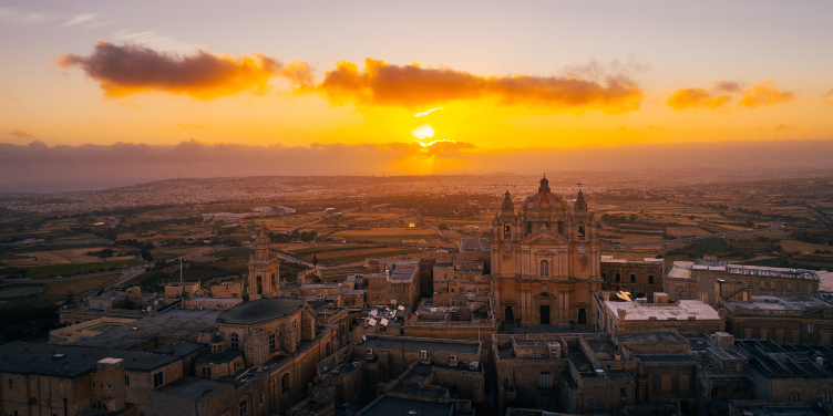 an image of the city of Mdina at sunset