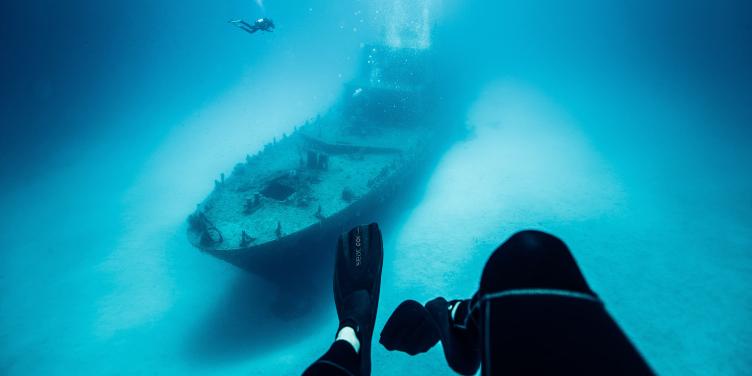 an image of divers exploring a shipwreck near Malta