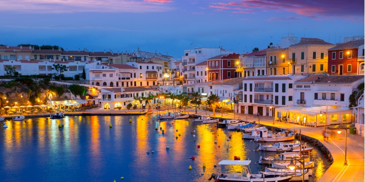 an image of Cales Fonts port, in Mahon, Menorca, at sunset