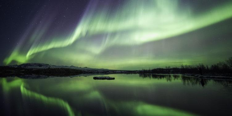 Northern lights over lake Thingvellir in Iceland
